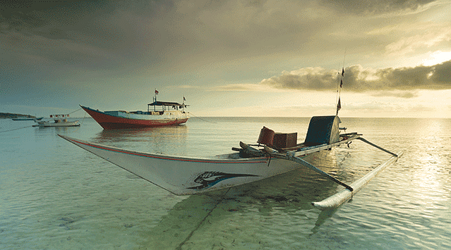 memotret perahu di pagi hari dengan kamera standar